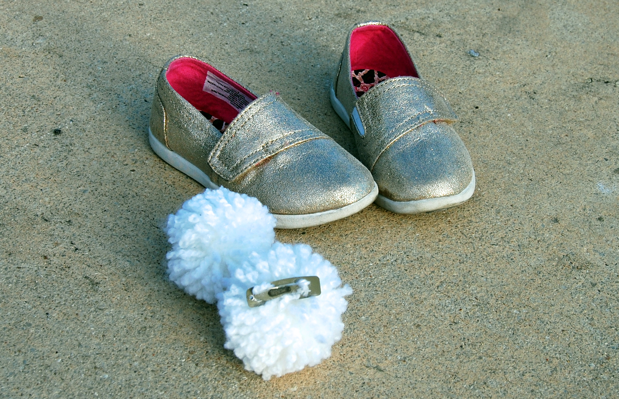 Tinkerbell shoes and pom poms